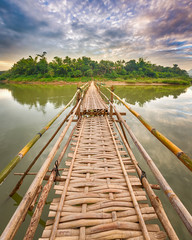 Beautiful view of a bamboo bridge. Laos landscape.
