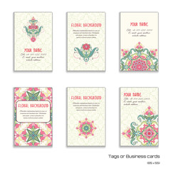 Set of six vertical business cards. Oriental floral pattern. Delicate ornament. Delicate green and pink.Place for your text.