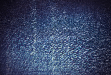 Texture of worn jeans. Rectangular horizontal denim background.