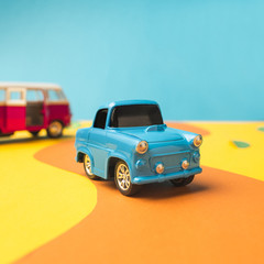 Vintage miniature car and bus in trendy color, travel concept