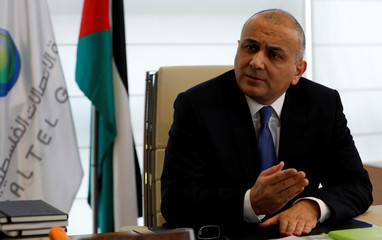 Ammar Aker, Chief Executive Officer at Paltel Group, gestures during an interview with Reuters in his office in the West Bank city of Ramallah