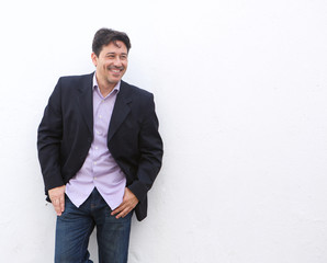 stylish mature businessman standing against white background