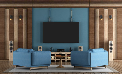 Home cinema room with TV hanging on blue wall
