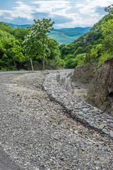 Cobbled road leading to Shiomghvime Monastery Complex, near Mtskheta and Tbilisi, Georgia, Eastern Europe.