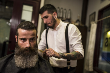 modern hairdressing. Beards, tattoos and hair art.