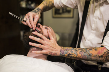 modern hairdressing. Beards, tattoos and hair art.