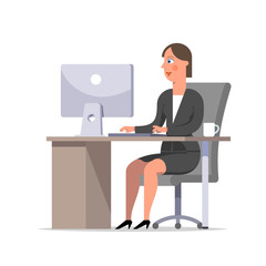 Businesswoman or clerk in a black suit sitting at the desk and working at the computer, looking at screen.