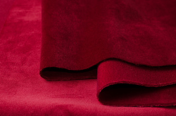 Bright red velour textile sample. Fabric texture background