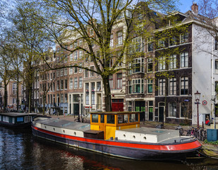 Boat in front of Canals in Canals of Amsterdam, Holland