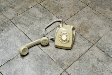 retro rotary telephone on a tiled floor