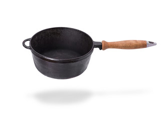 deep old black cast iron frying pan with wooden handle