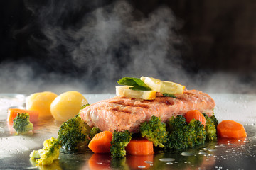 Salmon and steamed vegetables.