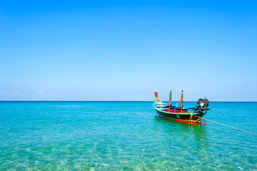 Long-tail boats converted boat excursions In order to serve tourists cruising the island of Andaman Sea coast beaches on a sunny day and the good weather in travel and  transportation concept.