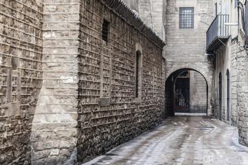 Ancient street stone walls in El Born quarter of Barcelona.