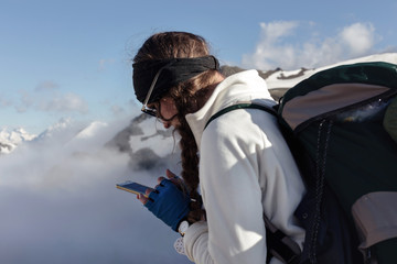 woman with a mobile phone in the mountains.
