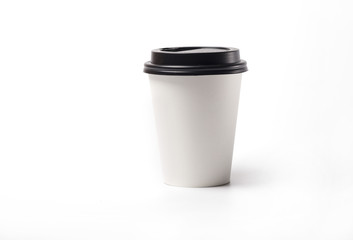 Isolate of a paper cup for coffee with a dark lid