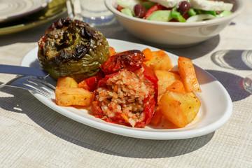 Rise stuffed fresh tomato and pepper in greek tavern.