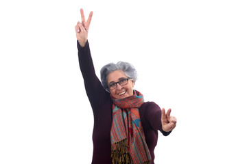 senior woman with victory sign on white