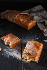 Homemade mini bread with fillers on dark wooden surface