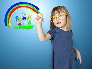 Cute little girl in yellow glasses draws herself and her family and a bright rainbow on glass.