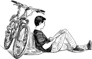 A cyclist resting on the city embankment