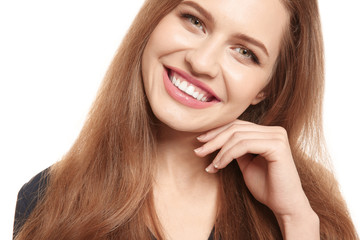 Portrait of smiling young woman, isolated on white