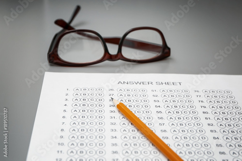 Pencil and test sheet on table, closeup  Preparation for
