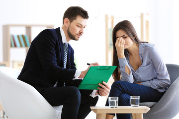 Male psychologist with patient in office