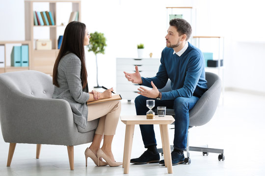 Female psychologist with patient in office