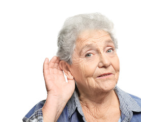 Elderly woman with hearing problem on white background