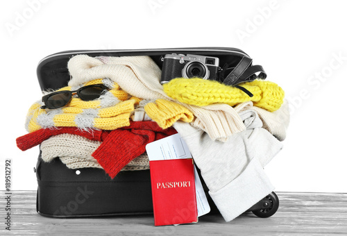 b2df47628a6 Open suitcase with warm clothes