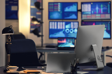 Stock exchange trader's workplace with computers