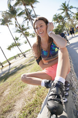 Roller skater listening to music with headphones