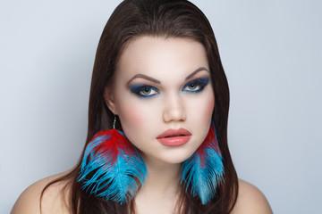 woman big earrings
