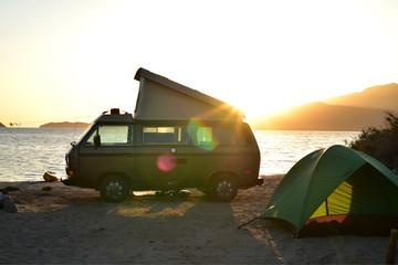 pop-up camper van and tent dawn sky