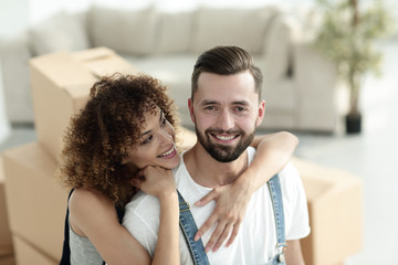 Close-up portrait of a newlywed couple on a background of boxes