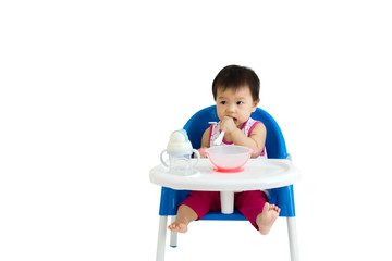 Portrait of a cute baby sitting in chair for eat. Isolated on white background with copy space