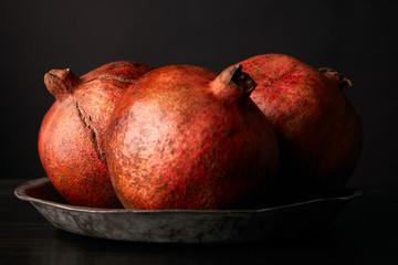 Fresh juicy pomegranate on black background
