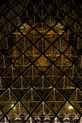 The pyramid of the Louvre Art Museum lit up at night