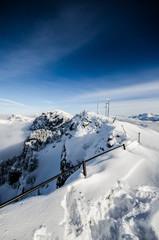 white mountain ridge under blue skies
