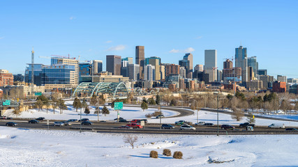 Winter at Downtown Denver - A winter panoramic view of Denver skyline and its busy street and highway I-25 after a snow storm. Colorado, USA.