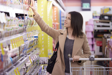 woman doing shopping at supermarket