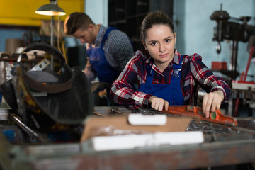 woman worker is working with level