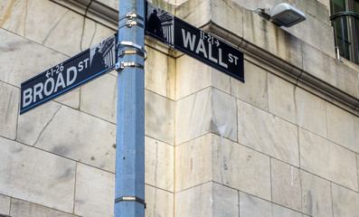 Wall St and Broad St Sign, Stock Exchange, Manhattan, New York, NY, USA on the 30th of July, 2017