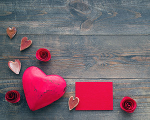 Heart and red card with space for your text, flower on a wooden background. Romantic card. Gift by St. Valentine's Day.