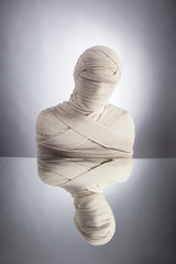 Awakening of mummy. Escape of everyday routine concept. Man wrapped in bandages as egyptian mummy.