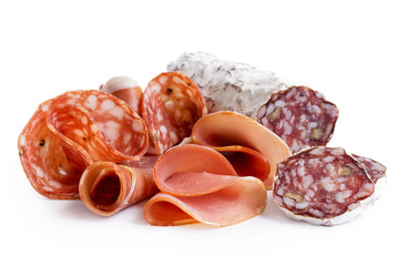 Mixed air cured sliced meats isolated on white.