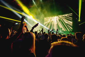 dj night club party rave with crowd in music festive