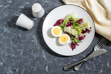 Light breakfast. Boiled eggs and salad mix