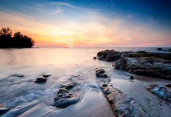 sunset seascape at Kudat, Malaysia. image contain soft focus due to long expose and water movement.